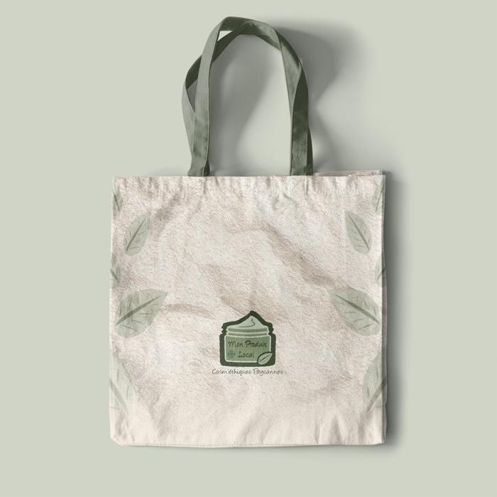 présentation de logo créé pour une boutique en ligne de cosmétiques locales sur un sac en toile